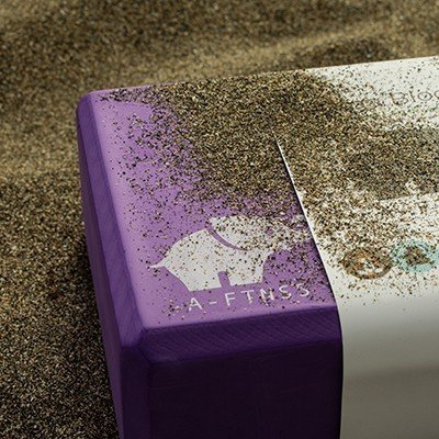 Yoga Block Purple in the sand