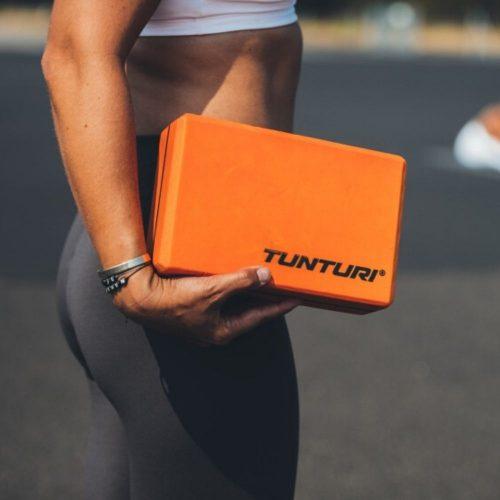 Tunturi yoga block orange holding in hand